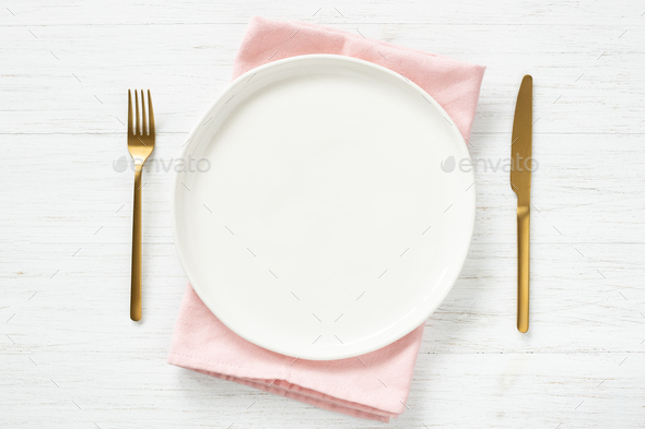 Empty Plate on Napkin and Golden Cutlery. - Stock Photo - Images