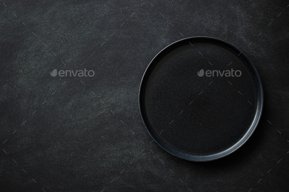 Empty Black Plate on Black Table. - Stock Photo - Images