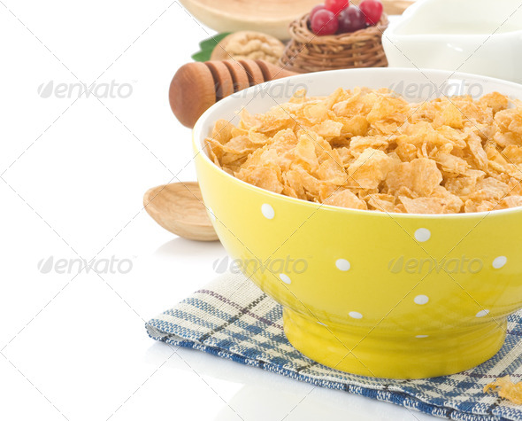 Bowl of corn flakes and milk isolated on white - Stock Photo - Images