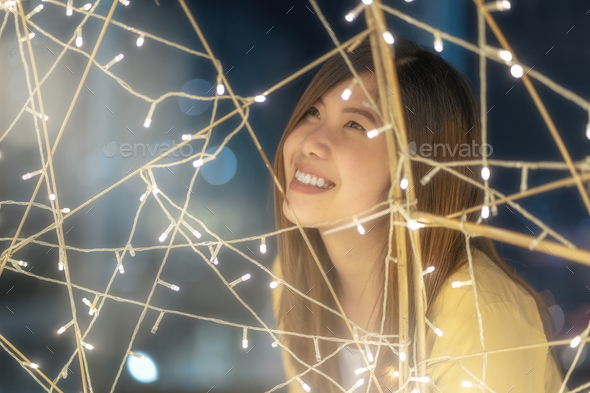 Closeup Portrait of asian woman with light at night, merry christmas and new year celebration - Stock Photo - Images