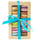 Different colorful macarons in craft box isolated on white background. - PhotoDune Item for Sale