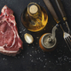 Fresh raw meat with spices on dark - PhotoDune Item for Sale