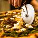 Chef Pizzer Preparing fresh Pizza for Serving. Restaurant Waiter at Work - PhotoDune Item for Sale