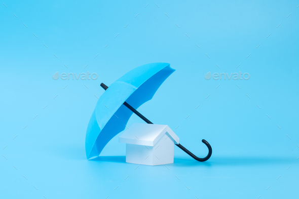 House model under blue color umbrella - Stock Photo - Images