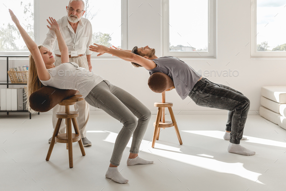 Working on spine mobility - Stock Photo - Images