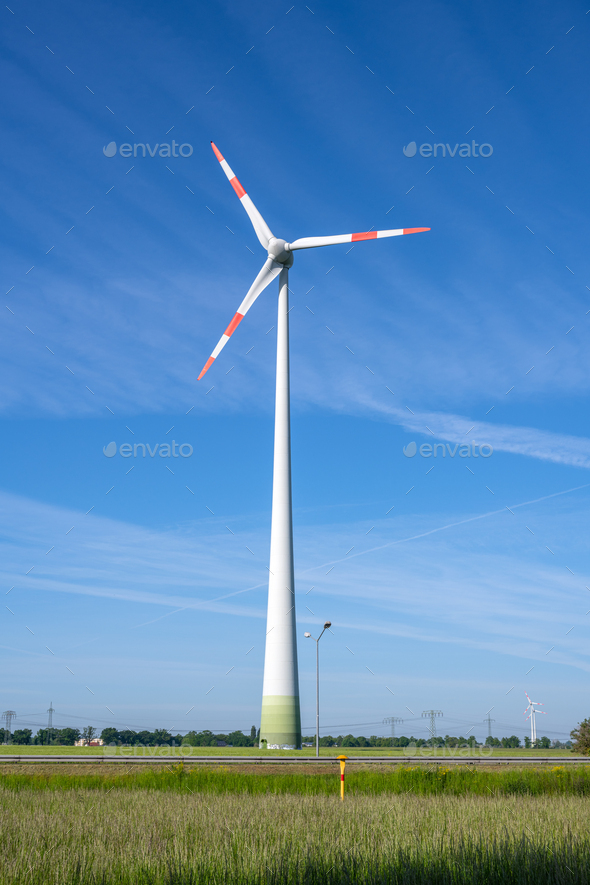 Wind turbine in front of a blue sky - Stock Photo - Images