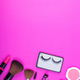A collection of cosmetic beauty products arranged around a blank space on a pink background. - PhotoDune Item for Sale
