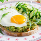 Avocado sandwich with fried egg and fresh salad cucumber with arugula - PhotoDune Item for Sale