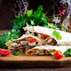 Grilled tortilla wraps with chicken and fresh vegetables on wooden board - PhotoDune Item for Sale