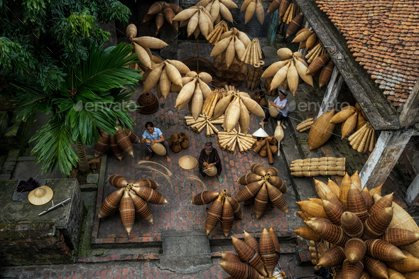 Top view of Group of Old Vietnamese female craftsman making the traditional bamboo fish - Stock Photo - Images
