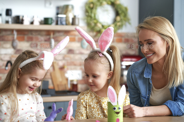 Happy mom with daughters during Easter time - Stock Photo - Images