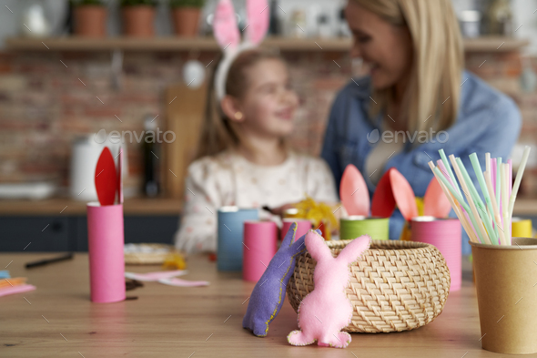 Handmade Easter rabbits and mom and daughter in the background - Stock Photo - Images
