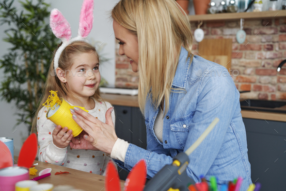 Mother and daughter preparing Easter decorations at home - Stock Photo - Images