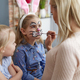 Mom painting Easter bunny on her daughter's face - PhotoDune Item for Sale