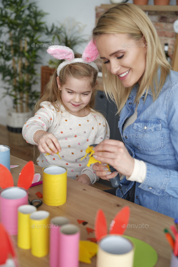 Happy mom and daughter preparing Easter decorations together at home - Stock Photo - Images