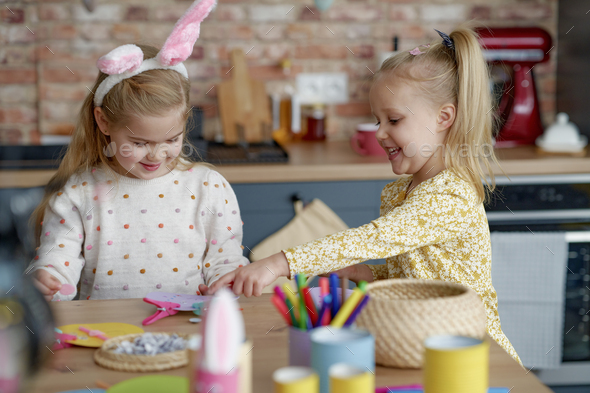 Two girls making decorations for Easter - Stock Photo - Images