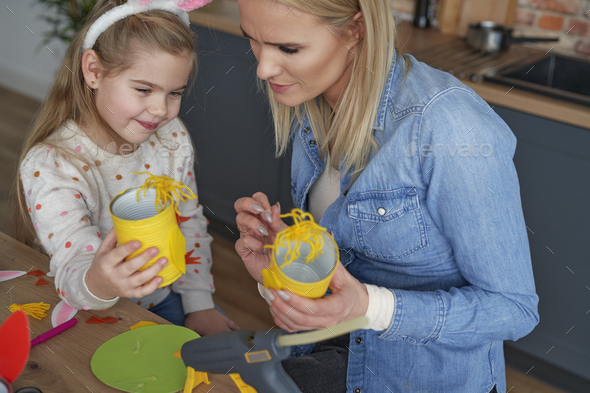 Top view of mom and daughter with Easter accessories - Stock Photo - Images