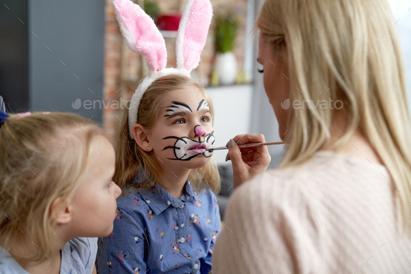 Close up of face painting for little Easter bunny at home - Stock Photo - Images