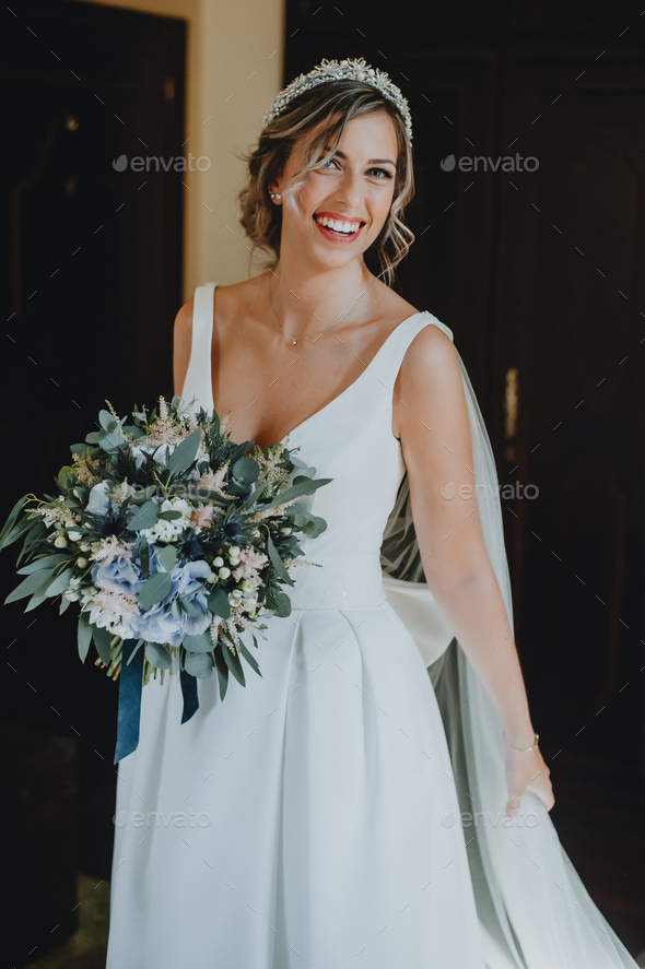 Portrait of a bride with her bouquet - Stock Photo - Images