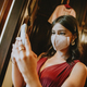 Bridesmaid with a surgical mask taking photos with her phone - PhotoDune Item for Sale