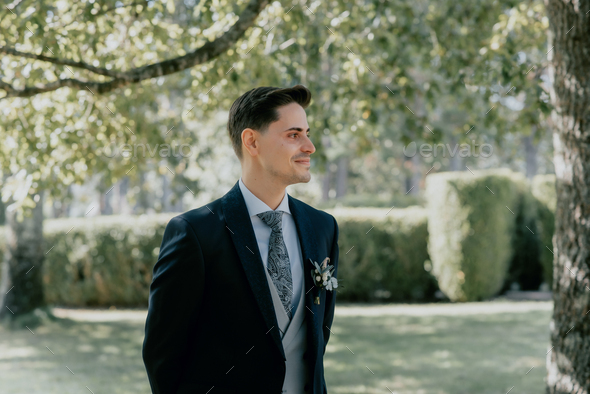 Groom waiting for the bride at the beginning of the wedding - Stock Photo - Images