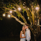 Just married couple under a tree at night - PhotoDune Item for Sale
