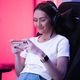 Young female teenage cyber sport gamer play mobile game by smartphone on eSport tournament - PhotoDune Item for Sale