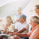 Cheerful different ages people stay together for lunch and drinking wine having a lot of fun - PhotoDune Item for Sale