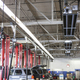 Rows of cars and trucks in auto repair shop - PhotoDune Item for Sale