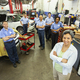 Portrait of a team of Mechanics in Auto Repair Shop viewed from above - PhotoDune Item for Sale