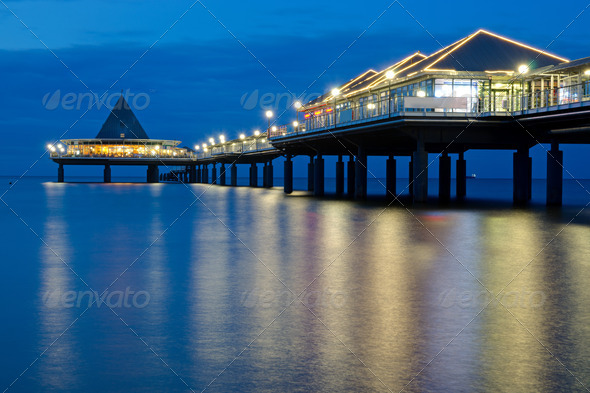 A pier on Usedom island after sunset - Stock Photo - Images