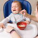 Mother tries to feed with spoon naughty infant kid refusing eating - PhotoDune Item for Sale