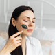 Beautiful european woman uses jade roller to massage her face - PhotoDune Item for Sale