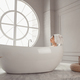 Young woman relaxing lying in bathtub in luxury bathroom with round large window - PhotoDune Item for Sale