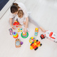 Top view on woman's and child playing with toys wooden on floor - PhotoDune Item for Sale