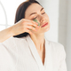 Young woman doing face Gua sha - chinese traditional massage - PhotoDune Item for Sale