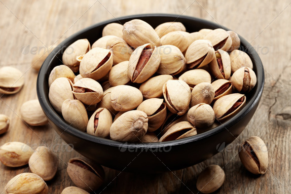close up of a bowl of pistachio nuts - Stock Photo - Images