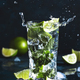 Mojito with splash and drops. Cocktail or mocktail with lime, mint, and ice in glass - PhotoDune Item for Sale
