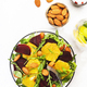 Beetroot Salad with Orange, arugula and almonds nut on white background - PhotoDune Item for Sale