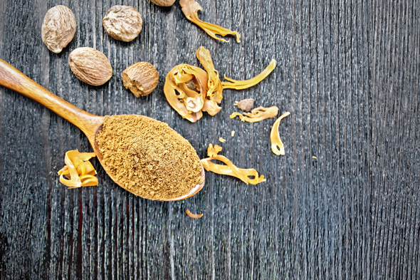 Nutmeg round in spoon on board top - Stock Photo - Images