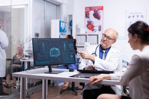 Senior physician showing scan body result to young patient - Stock Photo - Images