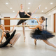Elegant teen ballerinas poses at barre in class - PhotoDune Item for Sale
