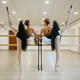 Elegant teen ballerinas, stretching at the barre - PhotoDune Item for Sale
