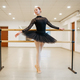 Ballerina poses at barre in class, ballet school - PhotoDune Item for Sale