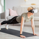 Exercising with virtual reality concept. Mature woman in VR headset standing in plank pose at home - PhotoDune Item for Sale