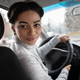Female driver talking to passenger in back seat or auto blogger - PhotoDune Item for Sale