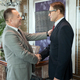 Happy mature businessman greeting foreign partner by handshake after negotiating - PhotoDune Item for Sale