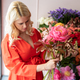Beautiful blonde florist woman picks up flowers and creates wonderful bouquet - PhotoDune Item for Sale