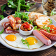 English breakfast - fried egg, beans, tomatoes, sausage, bacon and toast. - PhotoDune Item for Sale