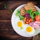 English breakfast - fried egg, beans, tomatoes, sausage,ham and toast. Top view, flat lay, overhead - PhotoDune Item for Sale
